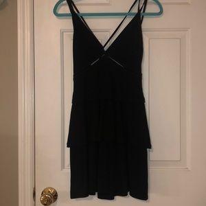 Open back, ruffled black dress